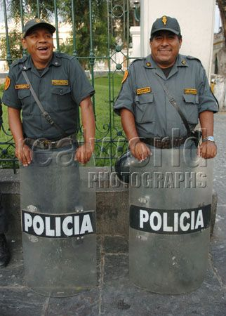 Two members of the military police share a laugh while patrolling a street in Lima, Peru, South America.